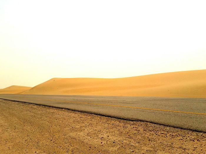 Empty Road Along Desert