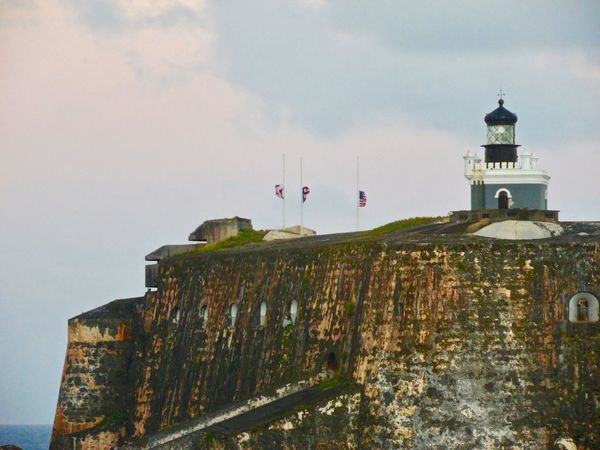 I was on a cruise leaving Puerto Rico, and saw the iconic fort as we were leaving the port. I had to take a few photos of the fort and the town as we were leaving. Architecture Building Exterior Built Structure Cloud - Sky Day Dome Guidance Lighthouse Nature No People Outdoors Protection Radar Sky