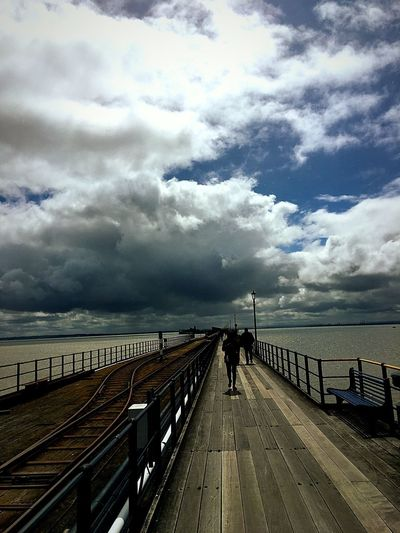 Cloud - Sky Sky Sea Water Railing Horizon Over Water Pier Jetty Day Outdoors Scenics Tranquil Scene Nature Beauty In Nature Tranquility Travel Destinations Beach Real People One Person Full Length Eye4photography  EyeEm Best Shots The Week Of Eyeem Picoftheday EyeEm Best Shots - Nature