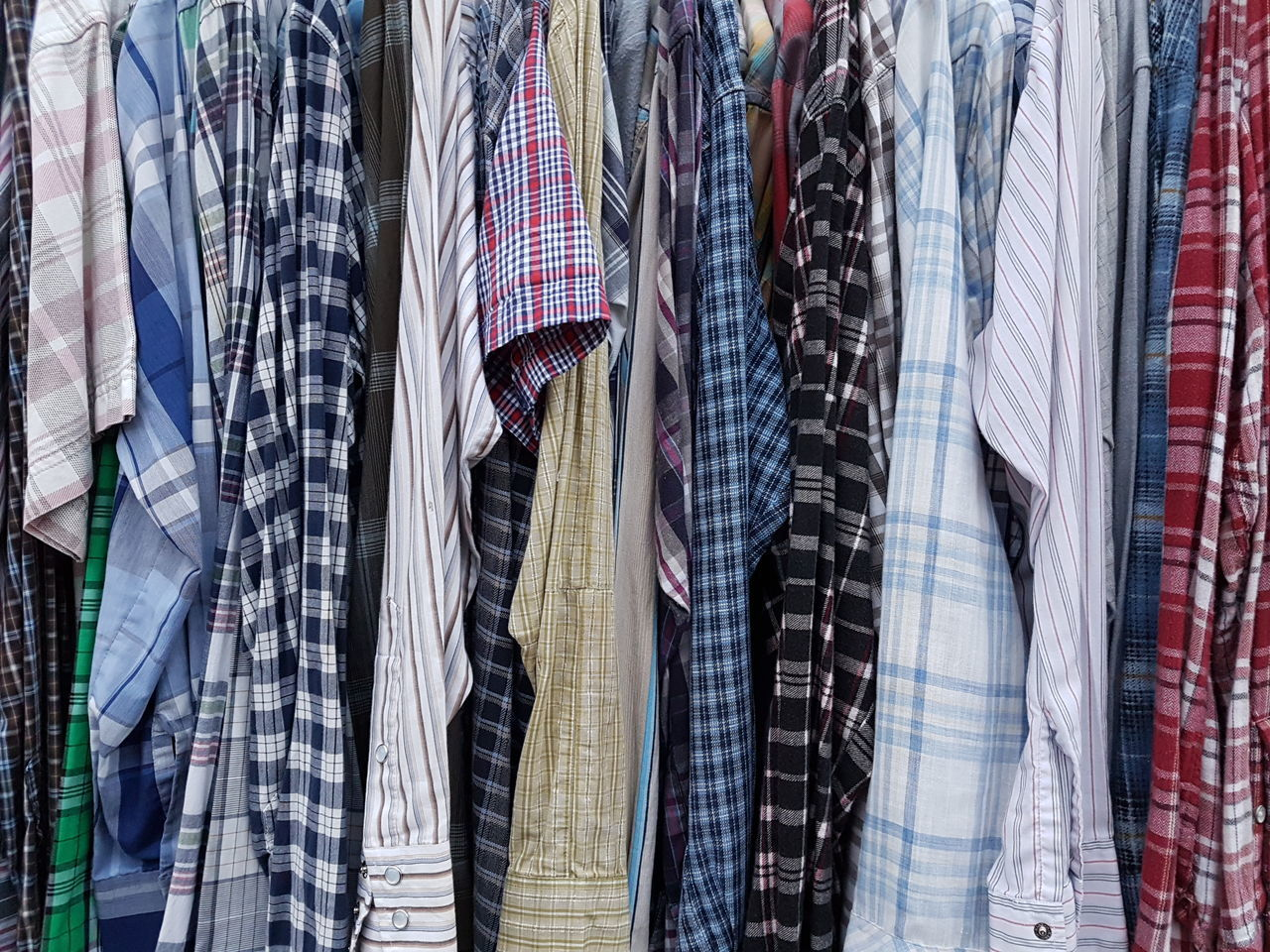 clothing, variation, checked pattern, hanging, retail, menswear, fashion, store, multi colored, backgrounds, indoors, no people, coathanger, close-up, day
