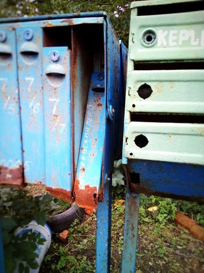 And yet it's difficult to believe that residents of quiet old courtyard like their mailboxes! Old Close-up Mailboxes Damaged Dilapidated Dilapidation