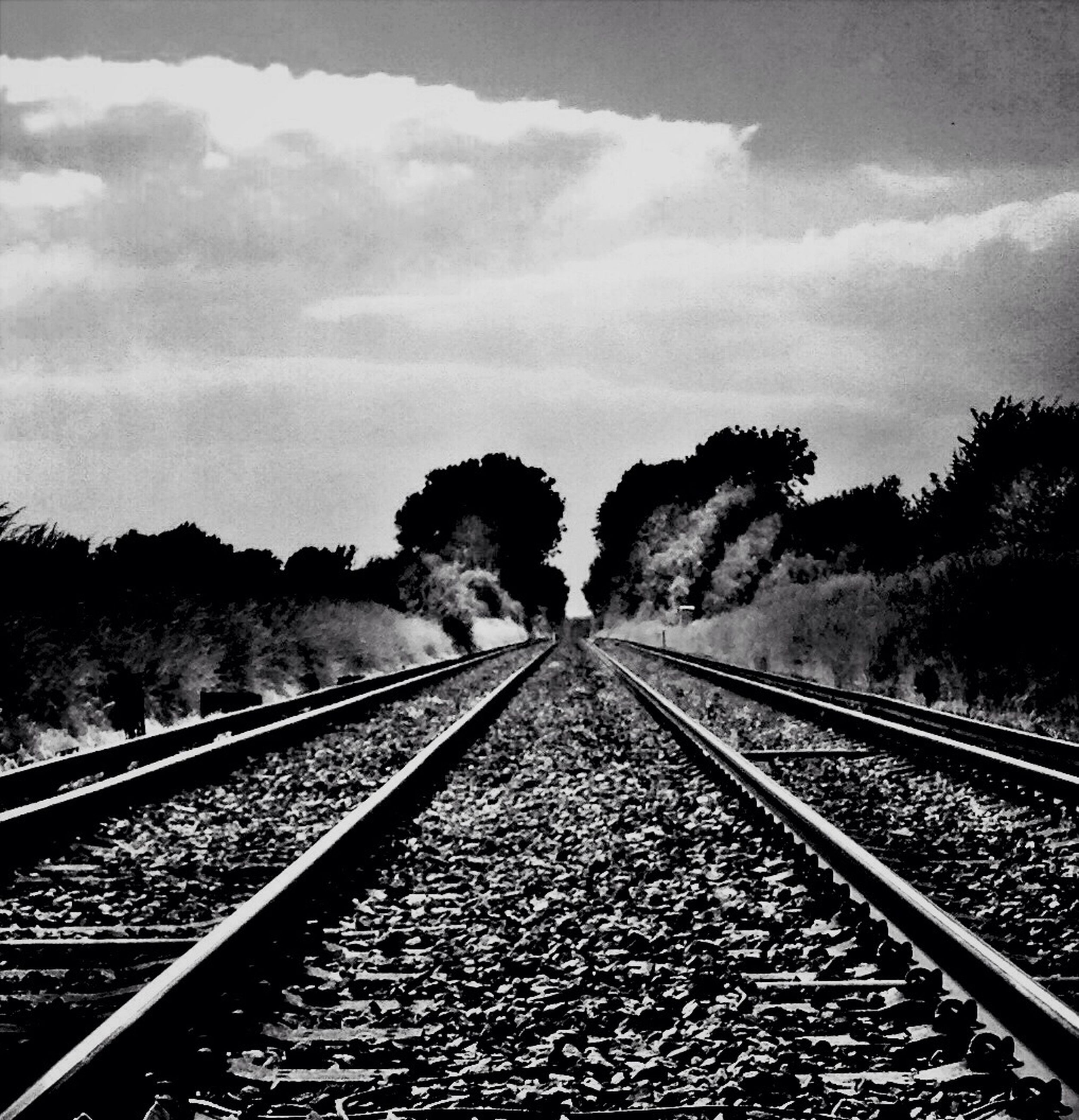 railroad track, rail transportation, transportation, diminishing perspective, the way forward, sky, vanishing point, tree, railway track, public transportation, cloud - sky, straight, day, metal, connection, outdoors, cloud, nature, no people, tranquility