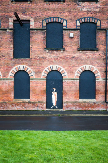 Grass Hepworth Gallery Architecture Black Windows Boarded Up Brick Building Building Exterior Built Structure Day Grass Area One Person Outdoors People Real People Statue Wakefield Window Window View