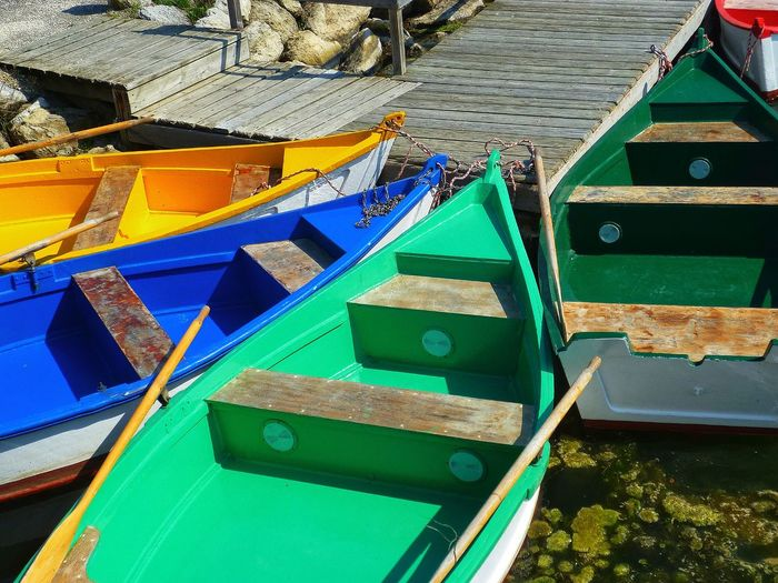 High angle view of multi colored boats moored at pier
