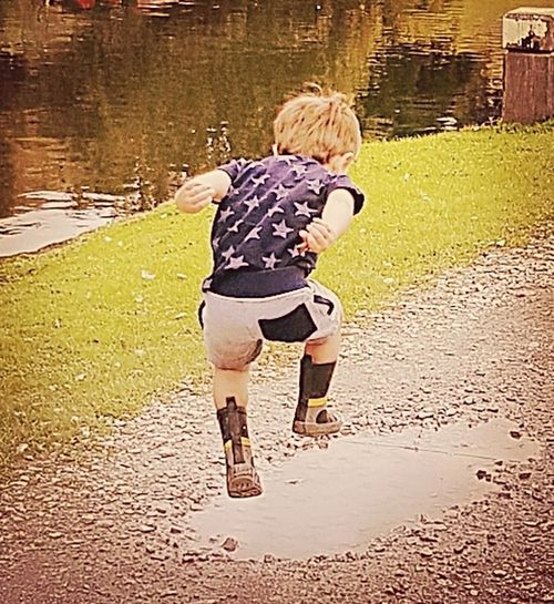 Action!! Rear View Full Length Day Walking Outdoors Two People Childhood Standing Togetherness Adult Water People Blond Hair Pets Children Only Domestic Animals Nature Mammal Young Adult Taking Photos The Week On EyeEm Boys Real People Males  Leisure Activity