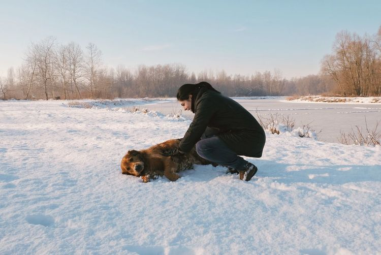 Winter Animal Themes Pets Dog Snow Cold Temperature Domestic Animals Mammal One Animal Nature Full Length Day Field Outdoors Playing Warm Clothing Beauty In Nature One Person EyeEm Best Shots Vscocam Fujifilm_xseries The Great Outdoors - 2017 EyeEm Awards