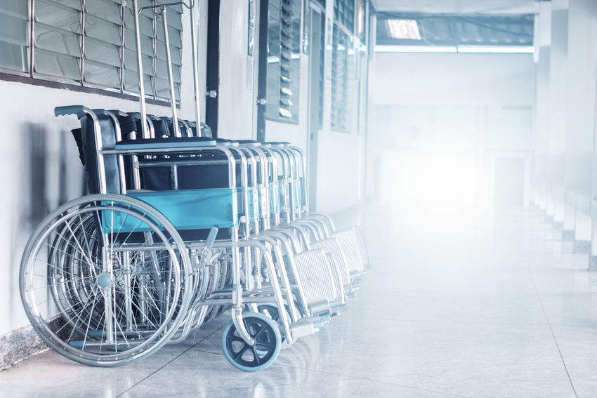 Hospital WhellChair Absence Arcade Architecture Building Convenience Corridor Day Differing Abilities Glass - Material Healthcare And Medicine Hospital Indoors  Lens Flare Medical Equipment No People Single Object Transportation Wheel Wheelchair Window