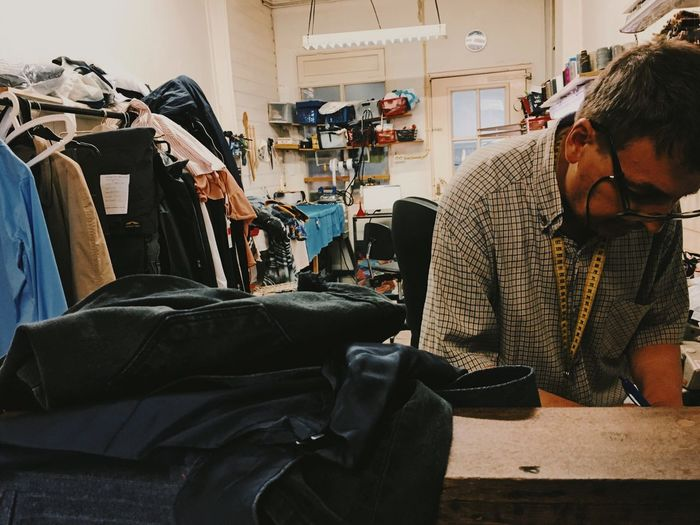 At the tailor getting the backpack ready Sowing Machine Sowing Working Day Working Days Job Clothing Store Clothing Retail  Small Shop Shop City Tailor Shop Tailoring Tailor Working Small Business Clothing Tailor Concentration Waist Up