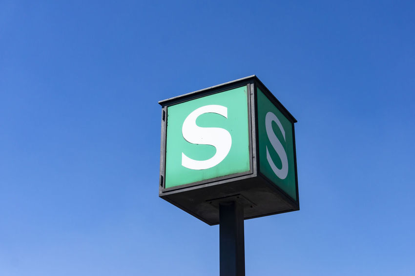 Berlin, Germany, May 14, 2018: Close-Up of Cubic S-Bahn Sign Against Blue Sky Berlin Germany 🇩🇪 Deutschland Horizontal S-Bahn Sign S-bahn Backgrounds Blue Capital Letter Clear Sky Color Image Communication Copy Space Day Green Color Guidance Information Sign Letter S Low Angle View No People Outdoors Sign Single Object Sky Text Western Script