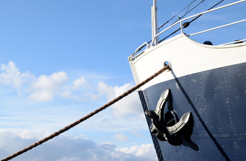 Low Angle View Of Anchor And Rope On Ship Against Sky