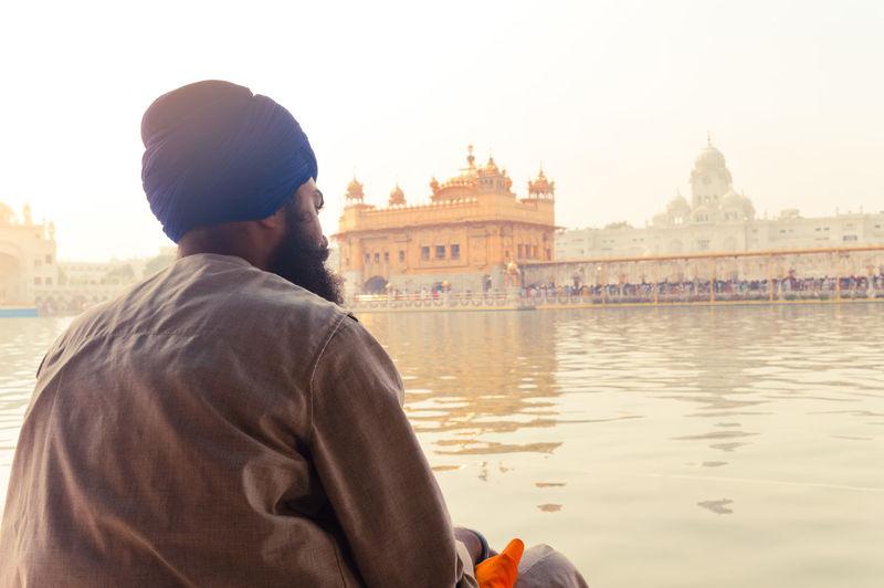 Man praying at golden temple