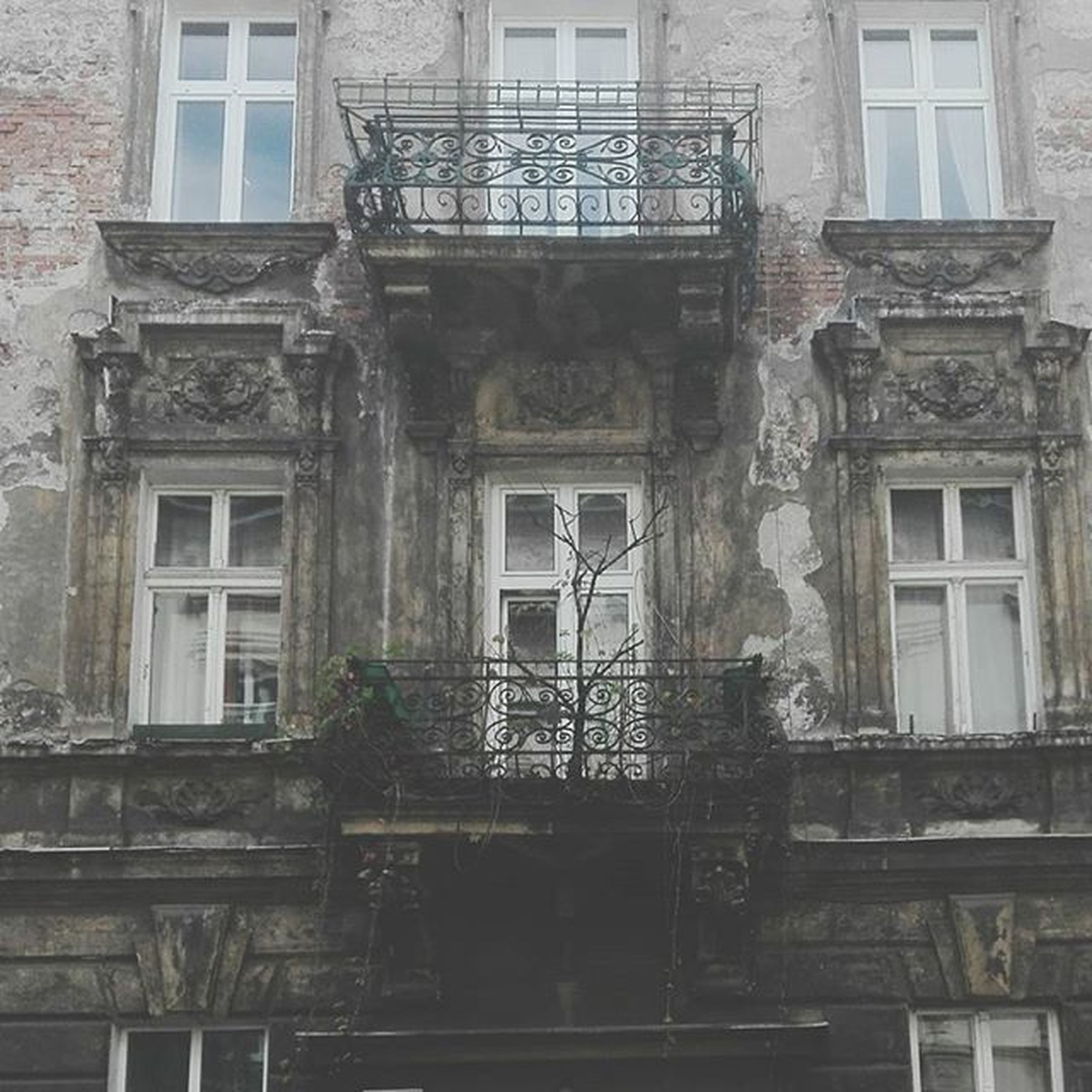 architecture, building exterior, built structure, window, building, residential building, old, residential structure, balcony, low angle view, house, weathered, day, door, facade, outdoors, railing, no people, city, full frame