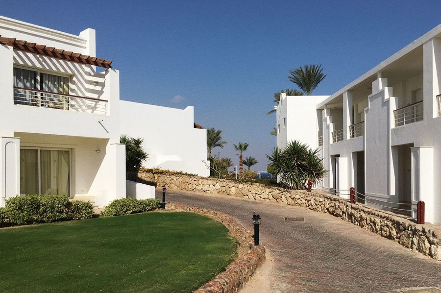 An Eye For Travel Egypt Resort Hotel Travel Architecture Building Exterior Built Structure Clear Sky Day House Nature No People Outdoors Residential Building Resort Sky Sunlight Tree Vaction Whitewashed