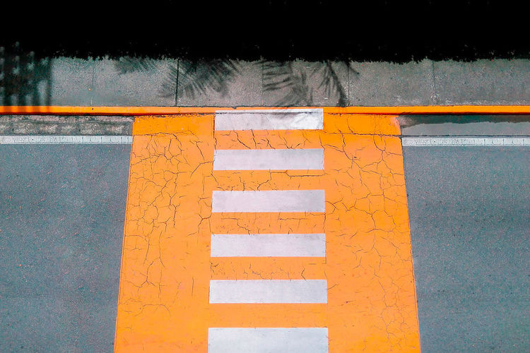 Architecture City Communication Day Direction Guidance High Angle View Marking No People Orange Color Outdoors Road Road Marking Safety Sign Symbol Text Transportation Western Script Yellow