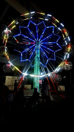 มานั่งเล่นชิงช้าสวรรค์กันป่ะ City Illuminated Arts Culture And Entertainment Ferris Wheel Amusement Park Sky Architecture Built Structure