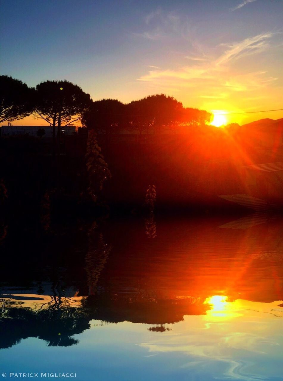 sunset, reflection, sky, nature, beauty in nature, tranquil scene, tranquility, scenics, tree, orange color, sun, outdoors, silhouette, sunlight, no people, water, lake, day