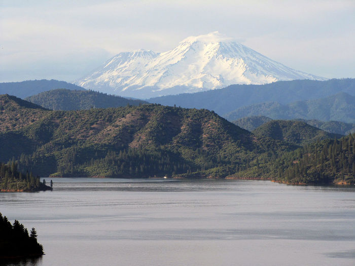 Scenic view of lake and mt shasta against sky