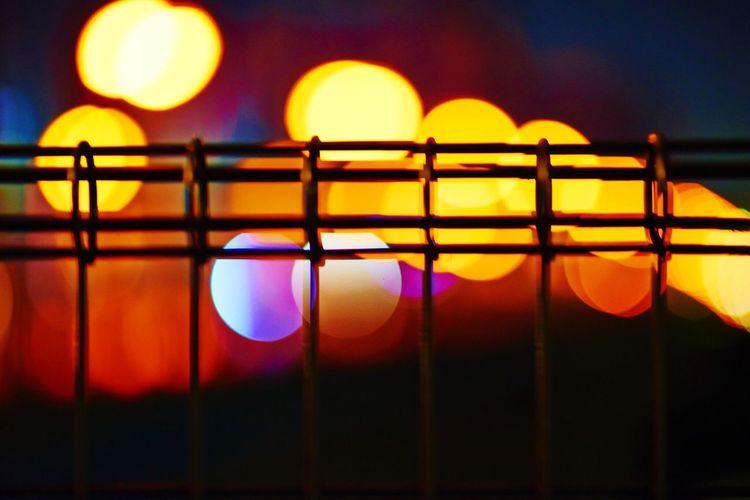 Defocused Image Of Illuminated Colorful Lights And Metal