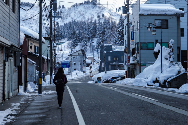 GALA Yuzawa YUZAWA Architecture Building Building Exterior Built Structure City Cold Temperature Day Incidental People Nature One Person Outdoors Plant Real People Road Snow Street Transportation Tree Walking Winter Yuzawa City