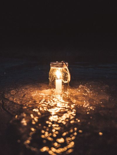 Illuminated Lighting Equipment Night Glowing Candle Burning Fire Flame No People Glass - Material Fire - Natural Phenomenon Close-up Indoors  Nature Beach Electricity  Light - Natural Phenomenon Copy Space Land Heat - Temperature