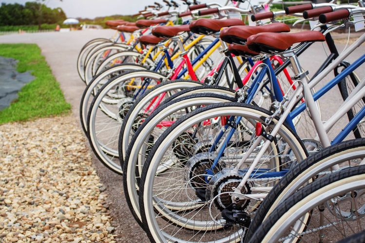 Close-Up Of Bicycles Parked On Street