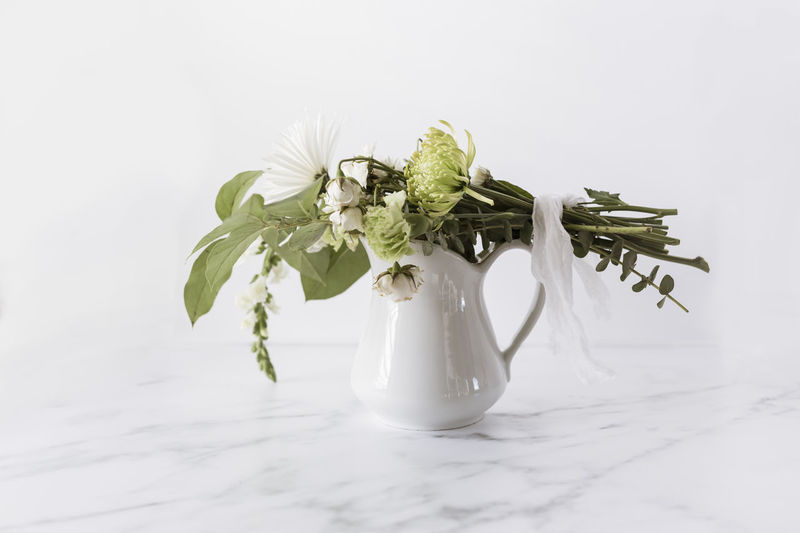 Close-up of white flower vase on table