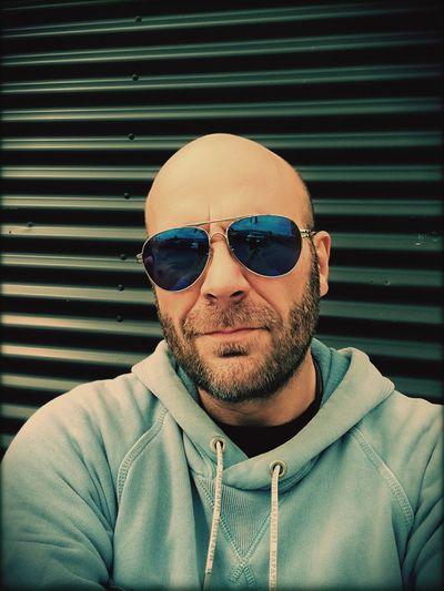 Portrait Of Man Wearing Sunglasses Against Shutter