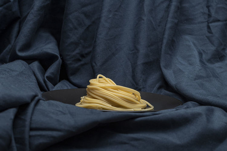 Close-up of yellow pipe on textile