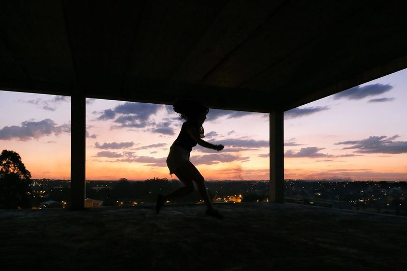 Alternative Fitness Jumping with a view. Jump Jumpshot Jumping Silhouette Silhouettes Silhouette_collection Sunset Sunset_collection Sunset Silhouettes View Horizon Sunlight End Of The Day Afternoon Girl Power