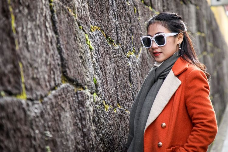 Sunglasses One Person Adult Portrait One Woman Only Only Women Fashion Stories Adults Only Fashion Standing Cold Temperature Women Young Adult Looking At Camera Fashion Stories