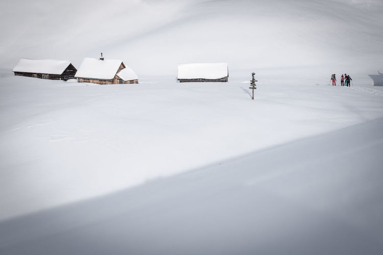 Snowy mountain huts in the Styrian alps Winter Snow Transportation Cold Temperature Winter Sport Mode Of Transportation Day Nature Frozen Ice White Color Travel Beauty In Nature Sport Outdoors Scenics - Nature Copy Space Group Of People Tranquility Mountain Hut