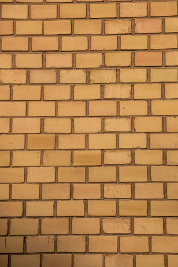 Old empty brick house factory wall with yellow bricks Full Frame Backgrounds Pattern Wall Built Structure Architecture Wall - Building Feature No People Brick Textured  Brick Wall Repetition Outdoors Large Group Of Objects Side By Side Abundance Building Exterior Close-up Day Yellow Stone Wall