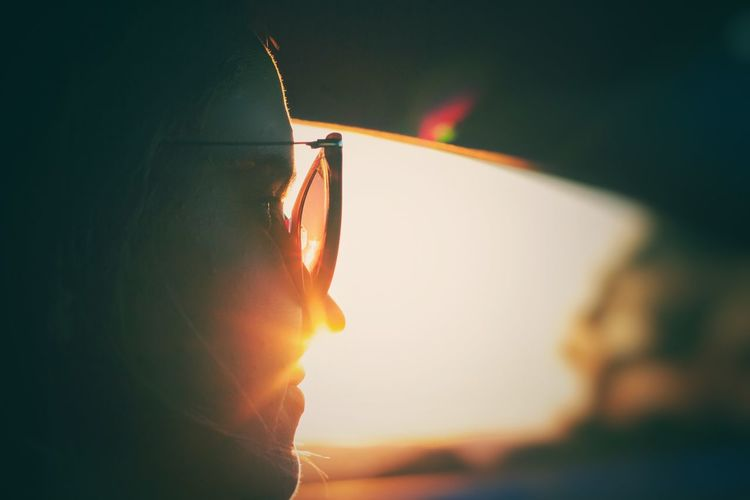 Journey Sundown On The Road Journey Driving Car Sunglasses Sunset Sunlight Sky Nature One Person Sun Close-up Focus On Foreground Lens Flare Beauty In Nature Orange Color It's About The Journey