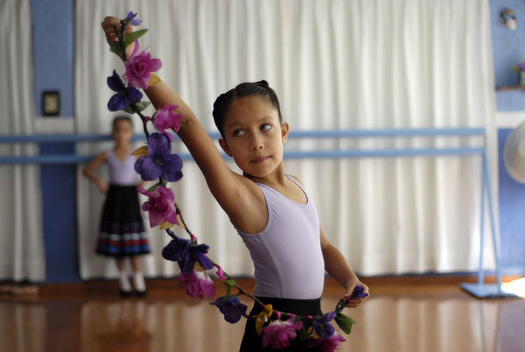 Ballet Dancer Holding Flower Decoration At Studio