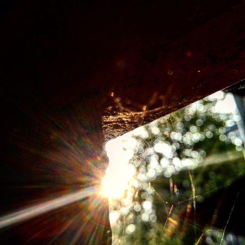 Close-up of illuminated car against sky