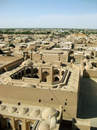 The ancient walled old town of Itchan Kala In Khiva or Xiva. Ichon Qala Desert Khiva New City Sandstone Buildings UNESCO World Heritage Site Uzbekistan Walled City Ancient Ancient Civilization Architecture Built Structure Former Soviet Union High Angle View History Horizon Itchan Kala Living Museum Sunny Day The Past Travel Destinations Uninhabited EyeEmNewHere An Eye For Travel