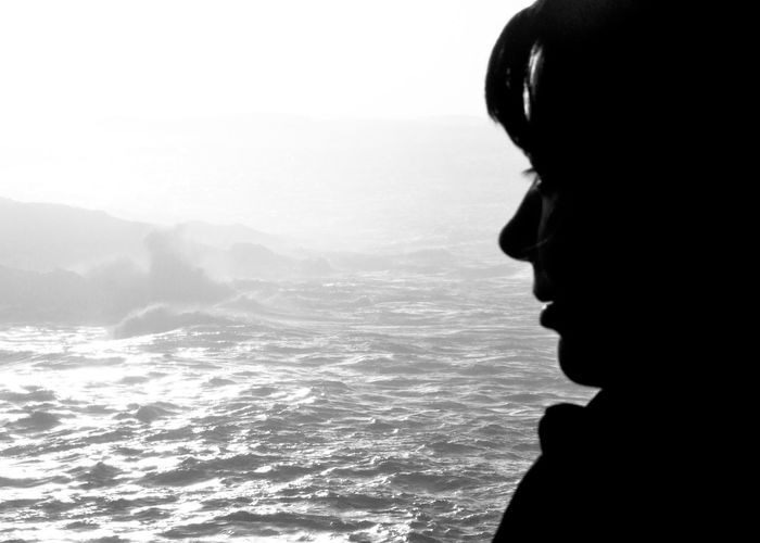 Beauty In Nature Black And White Blackandwhite Bright Sunshine Headshot Journey Light And Darkness  Light And Shadow Nature Ocean Outdoors Profile Remote Scenics Sea Silhouette Sunset Sunset Silhouettes Tranquil Scene Tranquility Traveling Water Wave Waves Crashing On Rocks Woman