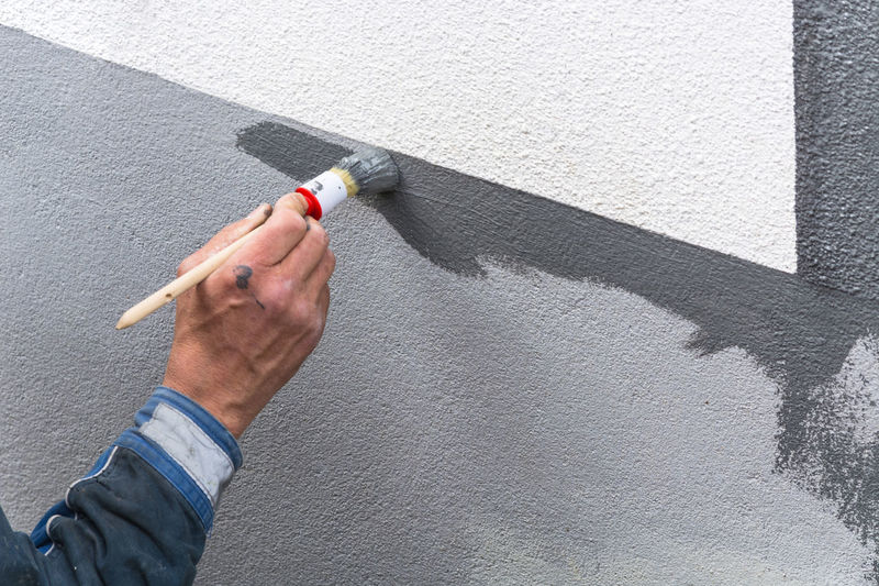 Cropped Image Of Hand Painting Wall