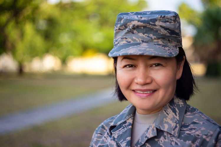 Portrait of smiling woman in military uniform
