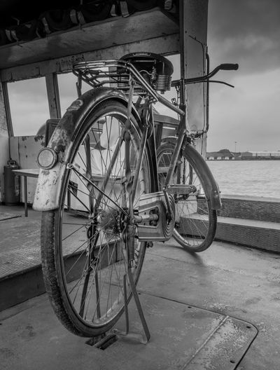 A Classic Old Bicycle on board a Ferry at Cochin, India. Classic Cycle Indian Travel Travel Photography Bicycle Blackandwhite Day Indiapictures Mode Of Transport Monochrome Monochrome Photography No People Old Cycle Old Is Gold Old Vehicle Outdoors Sky Sonyalpha Stationary Transportation Vintage Water Wheel The Week On EyeEm Black And White Friday