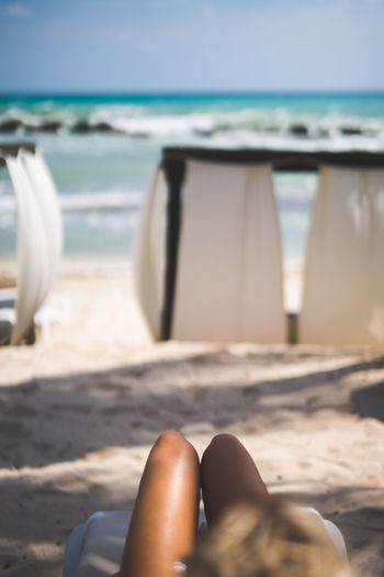 Beach Beauty In Nature Cabaña Close-up Day Focus On Foreground Horizon Over Water Human Body Part Human Leg Low Section Nature Ocean One Person Outdoors People Real People Relaxation Sand Shore Sky Summer Sunlight Vacations Water Women
