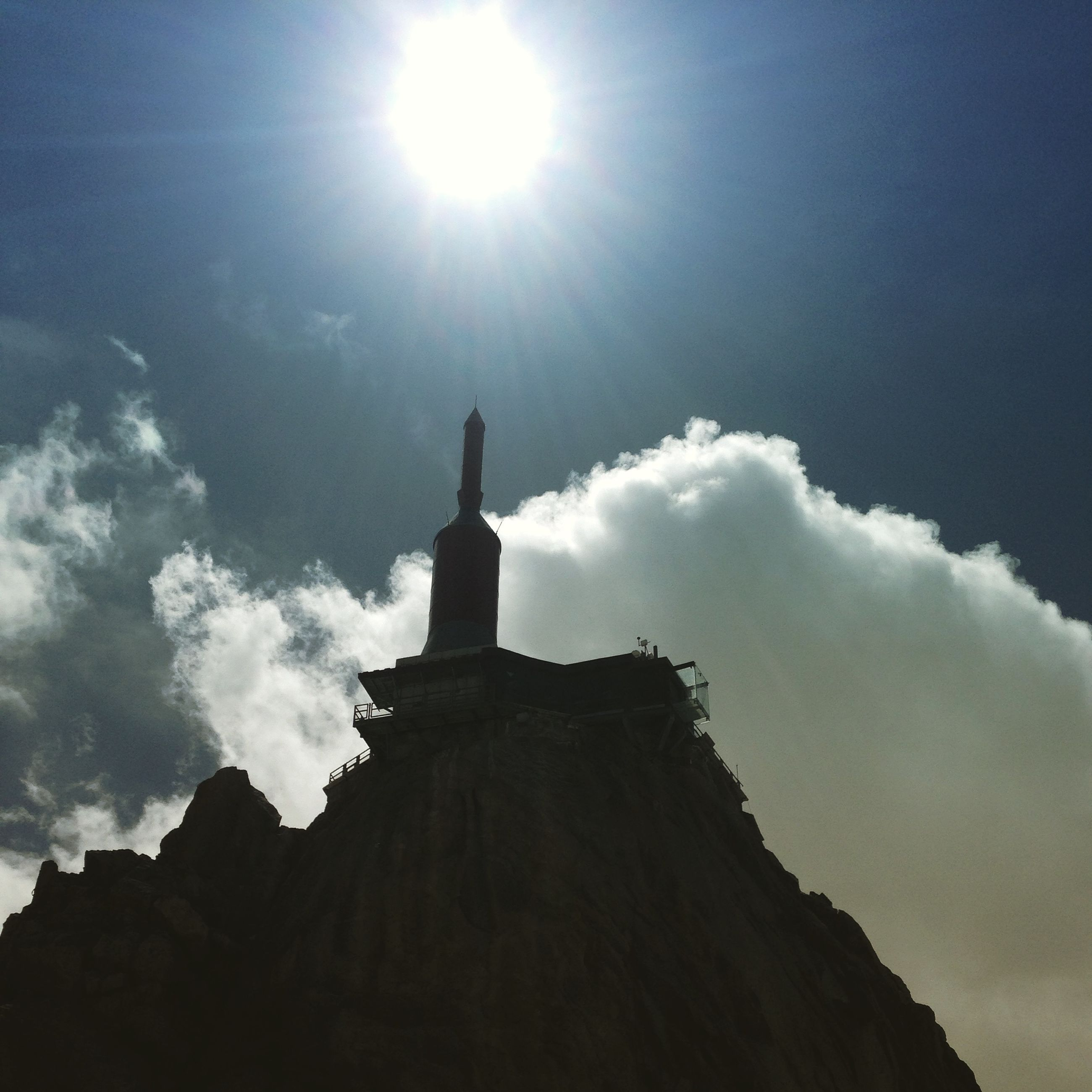 sun, low angle view, sunbeam, sky, religion, spirituality, sunlight, built structure, architecture, lens flare, place of worship, silhouette, building exterior, cross, cloud - sky, sunny, church, tranquility, nature