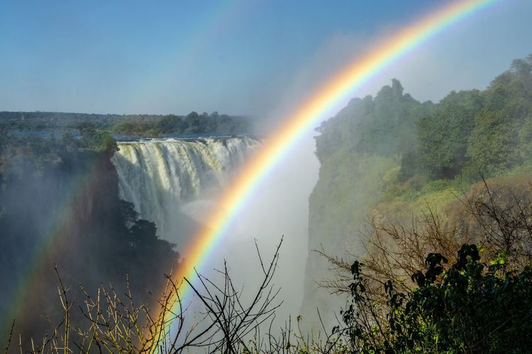 Scenic view of rainbow  at victoria falls