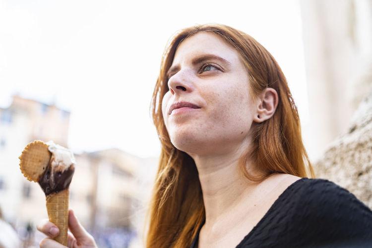 Portrait of woman holding ice cream
