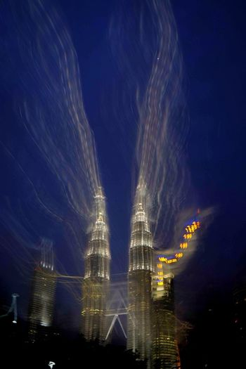 The magnificent national icon of Malaysia - the Petronas Twin Towers, the tallest bridged twin-towers in the world, 88 storeys, 452 m above street level, designed by master architect Cesar Pelli. Cesar Pelli Petronas Twin Towers Fujifilm Tallest Building Twin Towers Fujifilm_xseriesKualalumpur Suria KLCC Light Painting Special Effects