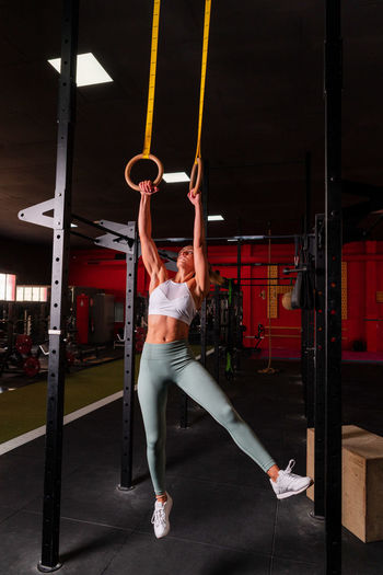 Full length of woman hanging on wall