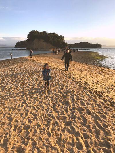 Angel Road, appears only low tide. 四国 砂浜 エンジェルロード 香川県 小豆島 Scenics Japan Lowtide  Path Island Kagawa Shodoshima Angelroad Beach Land Sky Water Sea Real People Sand Beauty In Nature Nature Scenics - Nature Sunlight Outdoors