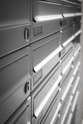 Full frame shot of metal mail boxes