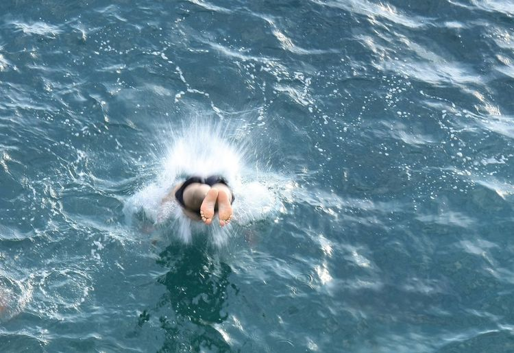 High angle view of person jumping into water