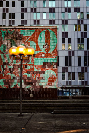 Architecture Built Structure Building Exterior Wall - Building Feature No People Graffiti Wall Outdoors City Day Building Brick Street Creativity Brick Wall Window Street Art Mural Windows Lamps Steps